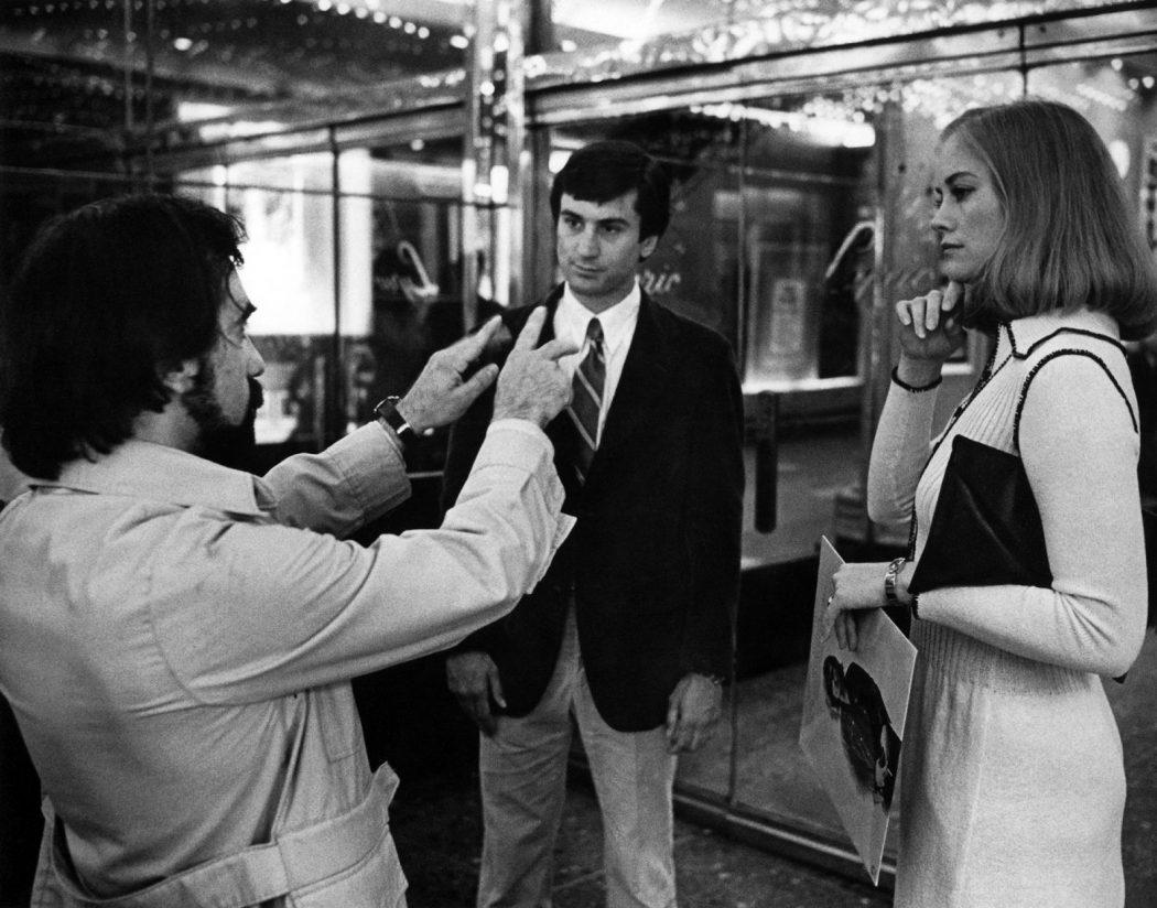 Martin Scorsese directs Robert De Niro and Cybill Shepard on the set of Taxi Driver. Photo credit: Ron Zarilla/Paul Kimatian