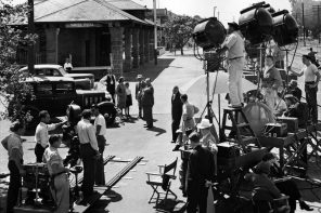 Alfred Hitchcock directs actors Teresa Wright, Edna May Wonacott, Henry Travers, and Charles Bates on location in Santa Rose, California, during the filming of Shadow of a Doubt © Universal Studios