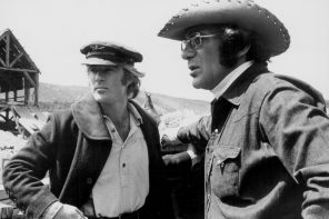 Plotting a scene: Robert Redford and director Sydney Pollack wait for the cameras and lights to be set up for filming Warner Bros.' Jeremiah Johnson on location in the mountains of Utah. Joe Wizan produced from John Milius and Edward Anhalt's screenplay. Getty Images © Warner Bros.