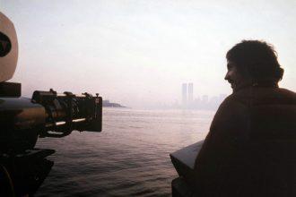 John Carpenter getting a shot of the New York skyline on the set of Escape from New York. Production still photographer: Kim Gottlieb © Embassy Pictures, International Film Investors, Goldcrest Films International