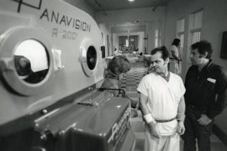 Miloš Forman directs Jack Nicholson on the set of One Flew Over the Cuckoo's Nest. Production still photographer: Peter Sorel © Archive of Miloš Forman, The Saul Zaentz Company